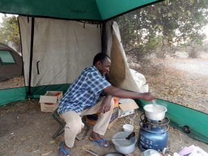 Japher preparing a meal