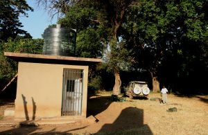 Simple shower and toilet facilities at public campsite Tanzania